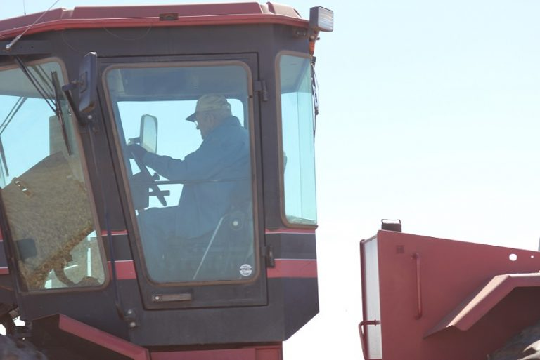 Ray Mikkonen driving the tractor